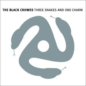 Three Snakes And One Charm album cover